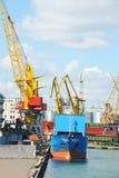 Bulk cargo ship under port crane Royalty Free Stock Images