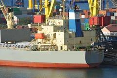 Bulk cargo ship under port crane Stock Image