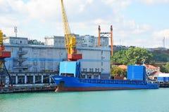 Bulk cargo ship under port crane Royalty Free Stock Photo