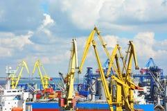 Bulk cargo ship under port crane Stock Photos