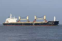 JIA LONG SHAN. Bulk carier JIA LONG SHAN on the river Elbe, operated by China Shipping Development, a Chinese shipping company with its headquarters in Shanghai stock images