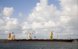 Bulk carrier. Unloading in IJmuiden, the Netherlands stock photography