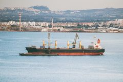 Bulk carrier. Bulk carrier ship in the bay royalty free stock photo