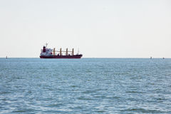 Bulk carrier cargo boat in bay Royalty Free Stock Photography