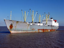 Bulk Carrier Cargo Ship Boat Sailing on Calm Water. Bulk carrier cargo ship sailing on calm waters stock images