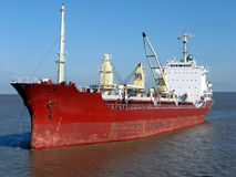 Bulk Carrier Cargo Ship Boat Sailing on Calm Water. Bulk carrier cargo ship sailing on calm waters Stock Image
