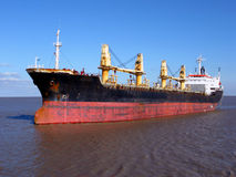 Bulk Carrier Cargo Ship Boat Sailing on Calm Water. Empty bulk carrier cargo ship sailing on calm waters stock images