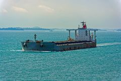 Bulk carrier cargo ship underway in sea. Laden bulk carrier cargo ship sailing along coastline royalty free stock images