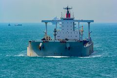 Bulk carrier cargo ship underway in sea. Laden bulk carrier cargo ship sailing along coastline royalty free stock image