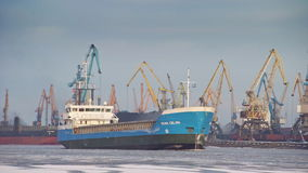 Bulk carrier entering port of Riga during winter stock video footage