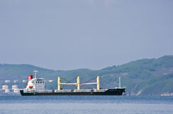 Bulk carrier Glorious Earth on the roads. Nakhodka Bay. East (Japan) Sea. 17.05.2014 Royalty Free Stock Image