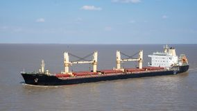 Bulk carrier. Going along the coast royalty free stock image