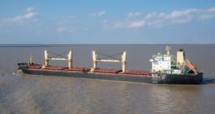 Bulk carrier. Going along the coast royalty free stock photos