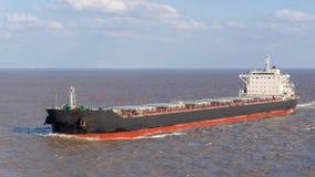 Bulk carrier. Going along the coast stock photography