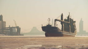 Bulk carrier leaving port of Riga during winter stock video