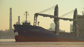 Bulk carrier leaving port of Riga during winter stock video footage