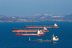 Bulk carrier Mineral Haiku, bulk carrier Twin Dragon, tanker Vladimir Vysotsky and tanker RN Polaris anchored in the roads. Nakhod Royalty Free Stock Photos