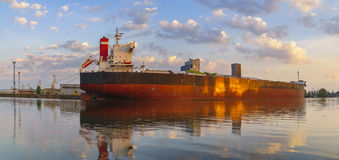 Bulk carrier moored at the quay, and busy with cargo operations. stock photos