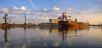 Bulk carrier moored at the quay, and busy with cargo operations. royalty free stock photography