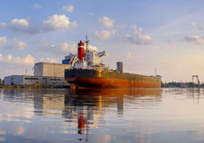 Bulk carrier moored at the quay, and busy with cargo operations. stock images