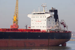 Bulk carrier. A bulk carrier in the port stock photo