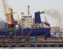Bulk carrier. A bulk carrier in the port stock photography