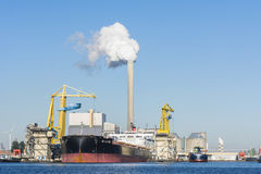 Bulk carrier in the port of Amsterdam. Royalty Free Stock Photos