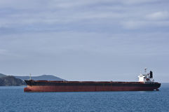 Bulk carrier Ricstar moves into port. Nakhodka Bay. East (Japan) Sea. 17.05.2014 Royalty Free Stock Images