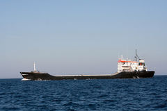 Bulk-carrier ship. Moving in the sea royalty free stock photos