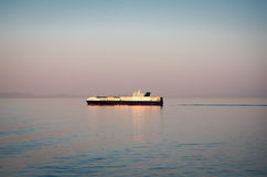 Bulk carrier ship. Container bulk carrier ship in a sea at dawn royalty free stock photo