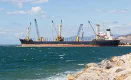 A bulk carrier ship loading cargo at port Royalty Free Stock Photos