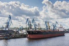 Bulk carrier ship loading coal Riga Royalty Free Stock Image