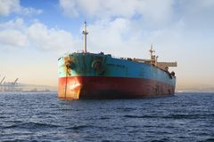 Bow view of bulk carrier ship Maersk Privilege anchored in Algeciras bay in Spain. Bulk carrier ship of Maersk company anchored and waiting for entrance in stock images