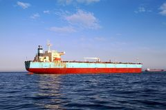 Bow view of bulk carrier ship Maersk Privilege anchored in Algeciras bay in Spain. Bulk carrier ship of Maersk company anchored and waiting for entrance in stock photo