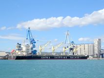 Bulk carrier ship in port. A China Shipping Bulker ship in the port of Sete in south of France royalty free stock image