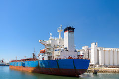 Bulk carrier ship. Unloading in the port stock images