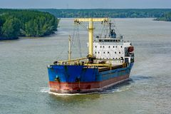 Bulk Carrier vessel sails down the Song Long River. Bulk Carrier vessel sails down the Song Long River from Ho Chi Minh City. It is in ballast, having royalty free stock photography