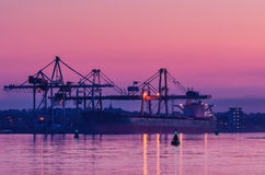 BULK CARRIER AT THE WHARF. At dusk during unloading royalty free stock photo