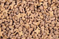 Bulk Cat Food. A pair of hands holding a pair of feet in socks Stock Photo
