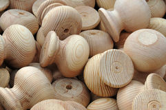 Bulk drawer and cupboard handles. A box full of wooden knobs for cupboards and drawer fronts Royalty Free Stock Image