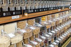 Bulk food dispensers. Of healthy nuts, grains, pasta, spices and much more royalty free stock photography