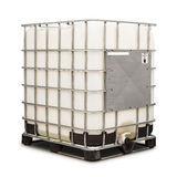 Bulk liquid container. Bulk plastic oil or liquid containers with metallic cage, isolated on white background with clipping path royalty free stock photo