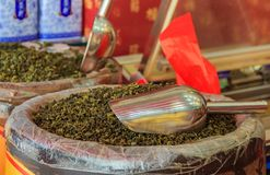 Bulk loose green tea for sale at the market in Xiamen China. Bulk loose green tea for sale in bags at the market in Xiamen, China stock image