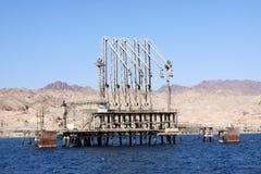 Bulk-oil terminal. The bulk-oil terminal and oil storage on seacoast royalty free stock images