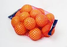 Bulk Oranges. Fresh tangerines in fruit net for bulk sale royalty free stock images