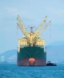 Bulk ship at anchor. Empty bulk ship at anchor in tropical waters stock photos