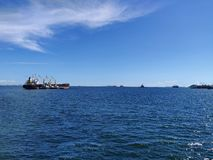 The bulk ship in anchorage. Nice weather day royalty free stock image