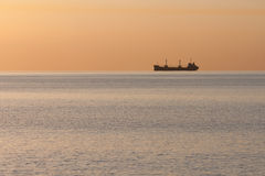 Bulk ship on the horizon. Bulk Ship with containers aerial at the horizon stock photography