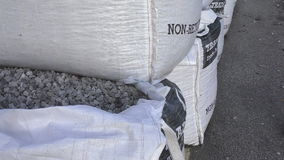 Bulkbags of stone chippings stock footage