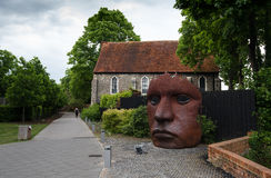 Bulkhead or the mask sculpture Canterbury Kent. Canterbury, Kent, England - May 15 2017: The face Mask or Bulkhead art created by Rick Kirby , British sculptor royalty free stock photos